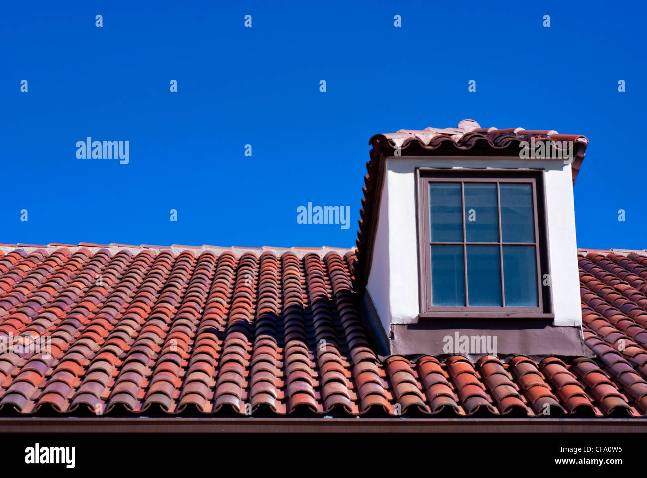 Ceramic tile roof and deep blue sky stock photo royalty free ceramic tile roof and deep blue sky dailygadgetfo Choice Image