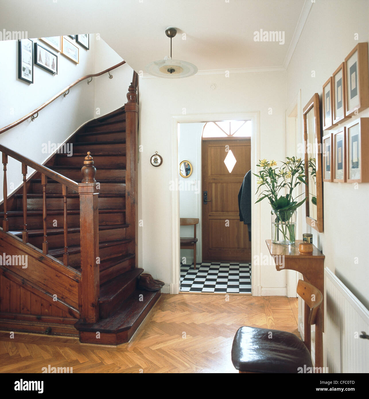 Hallway curved wooden staircase parquet flooring and black and hallway curved wooden staircase parquet flooring and black and white tiles by front door magazine dailygadgetfo Choice Image