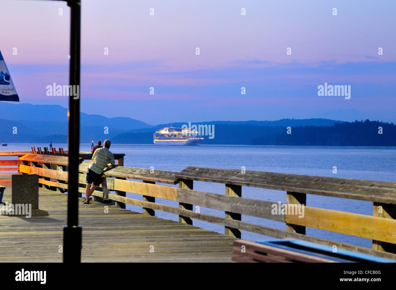 Cruise Ship Passing By The Fishing Pier At Dusk In Campbell River, British  Columbia, Canada