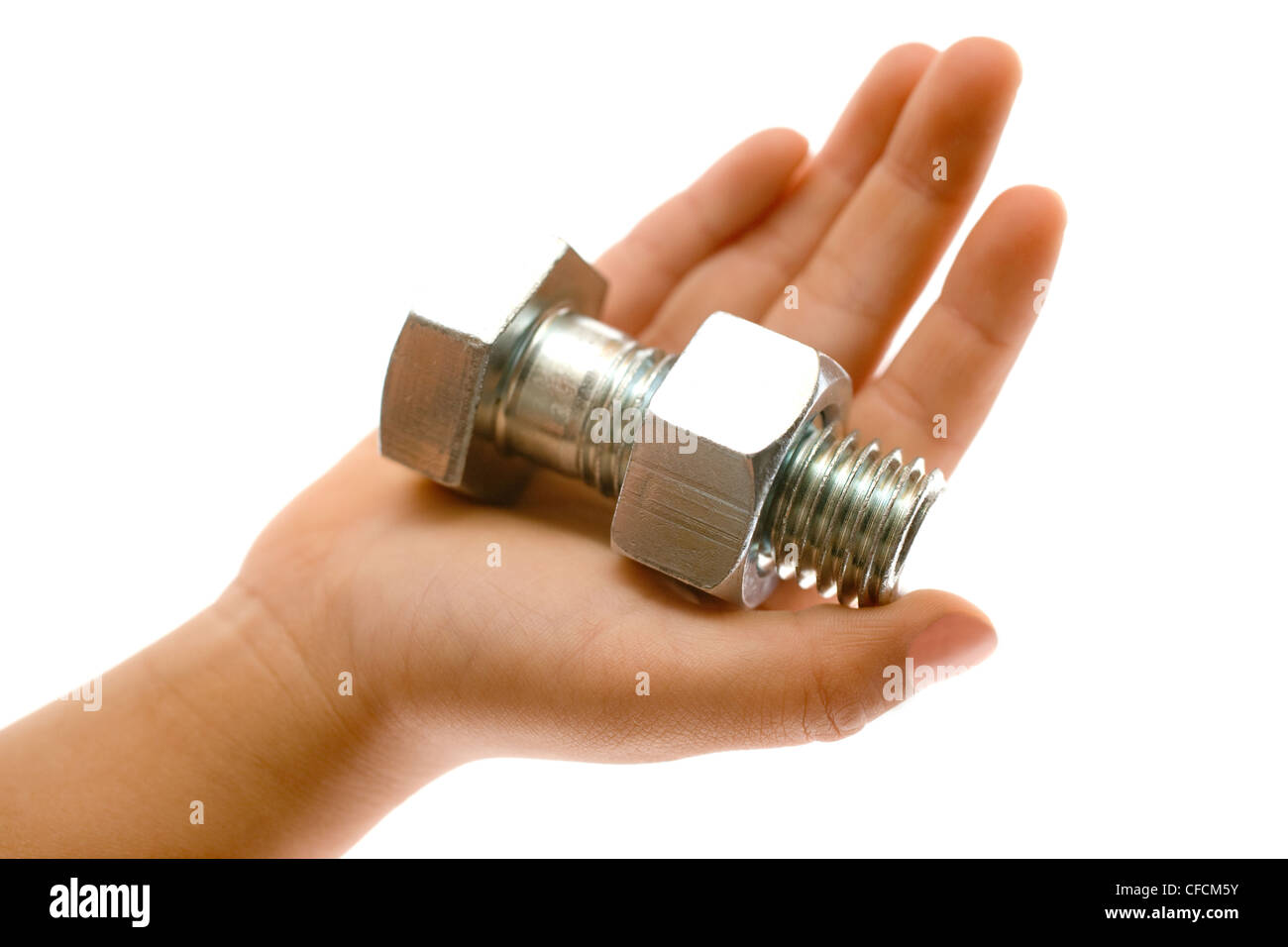 Large Nuts And Bolts : Hand holding a large silver metal bolt and nut over