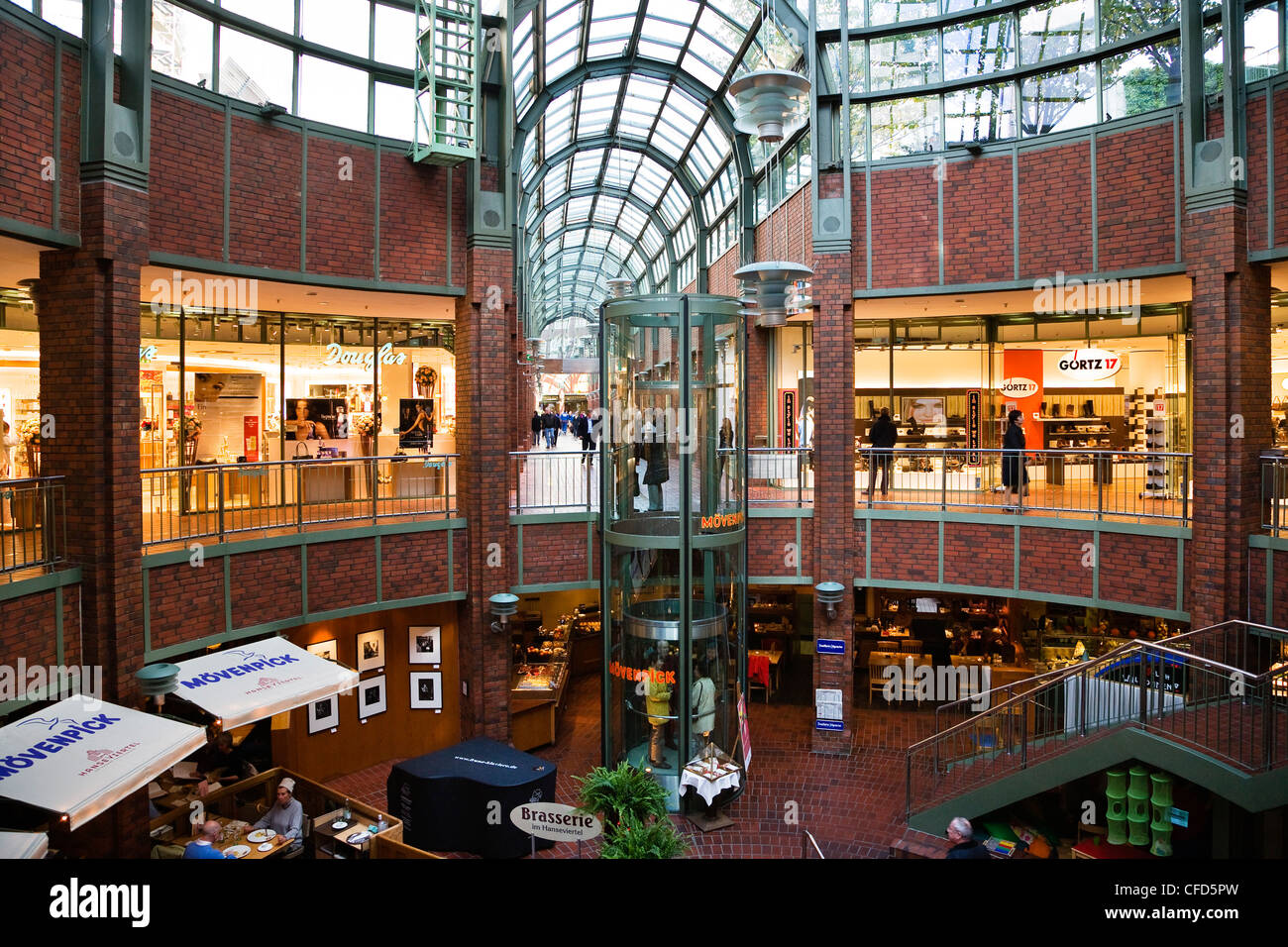 illuminated shops at a shopping center hanse viertel hamburg stock photo royalty free image. Black Bedroom Furniture Sets. Home Design Ideas