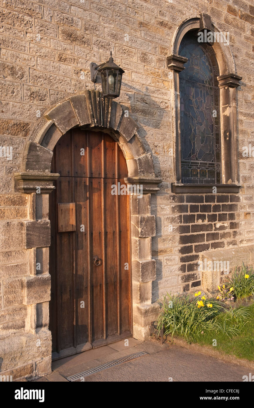 An Exterior View Of A Wooden Door And Stained Glass Window At St Stock Photo Royalty Free Image