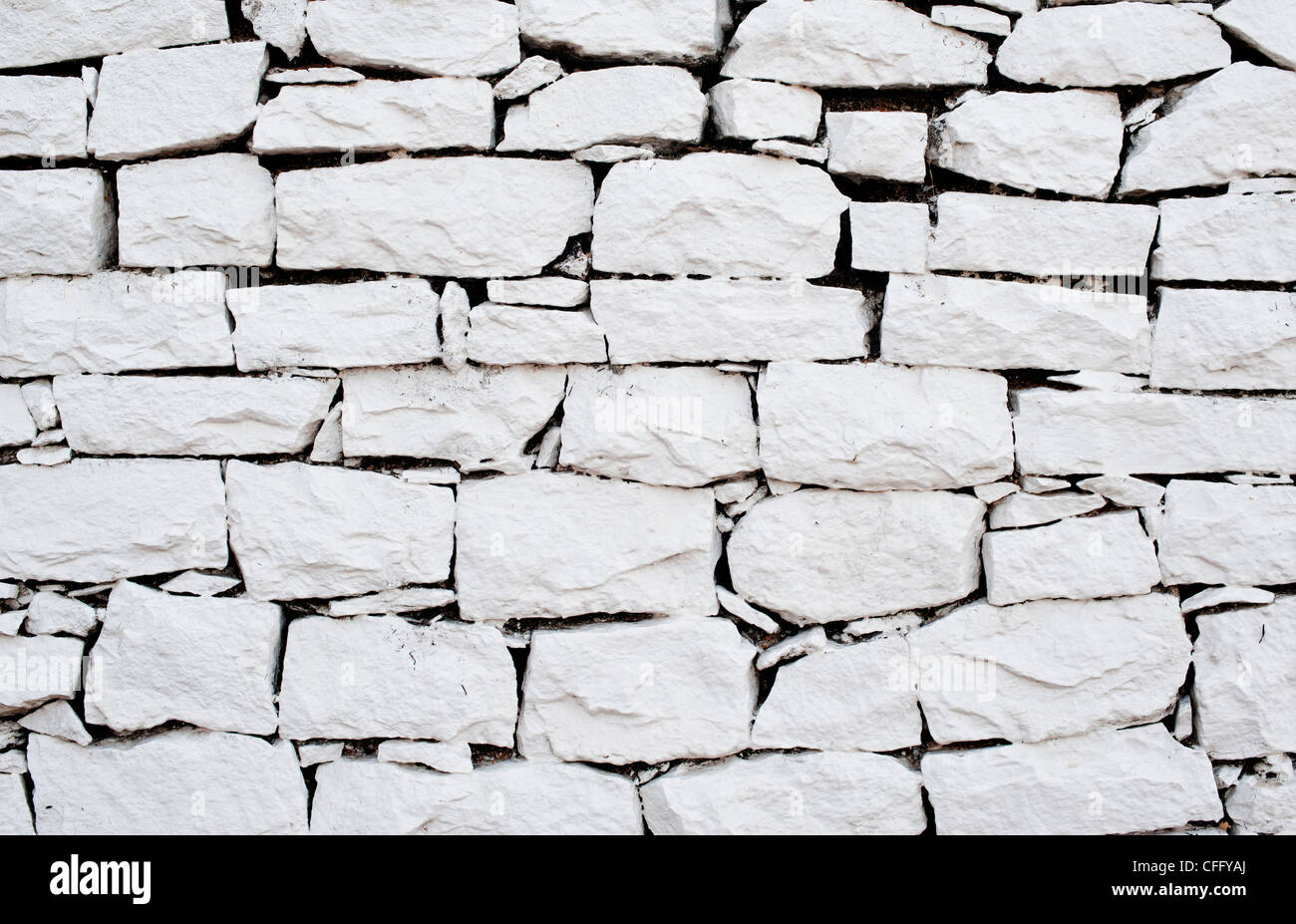 painted stone wallWhite painted dry stone wall Stock Photo Royalty Free Image