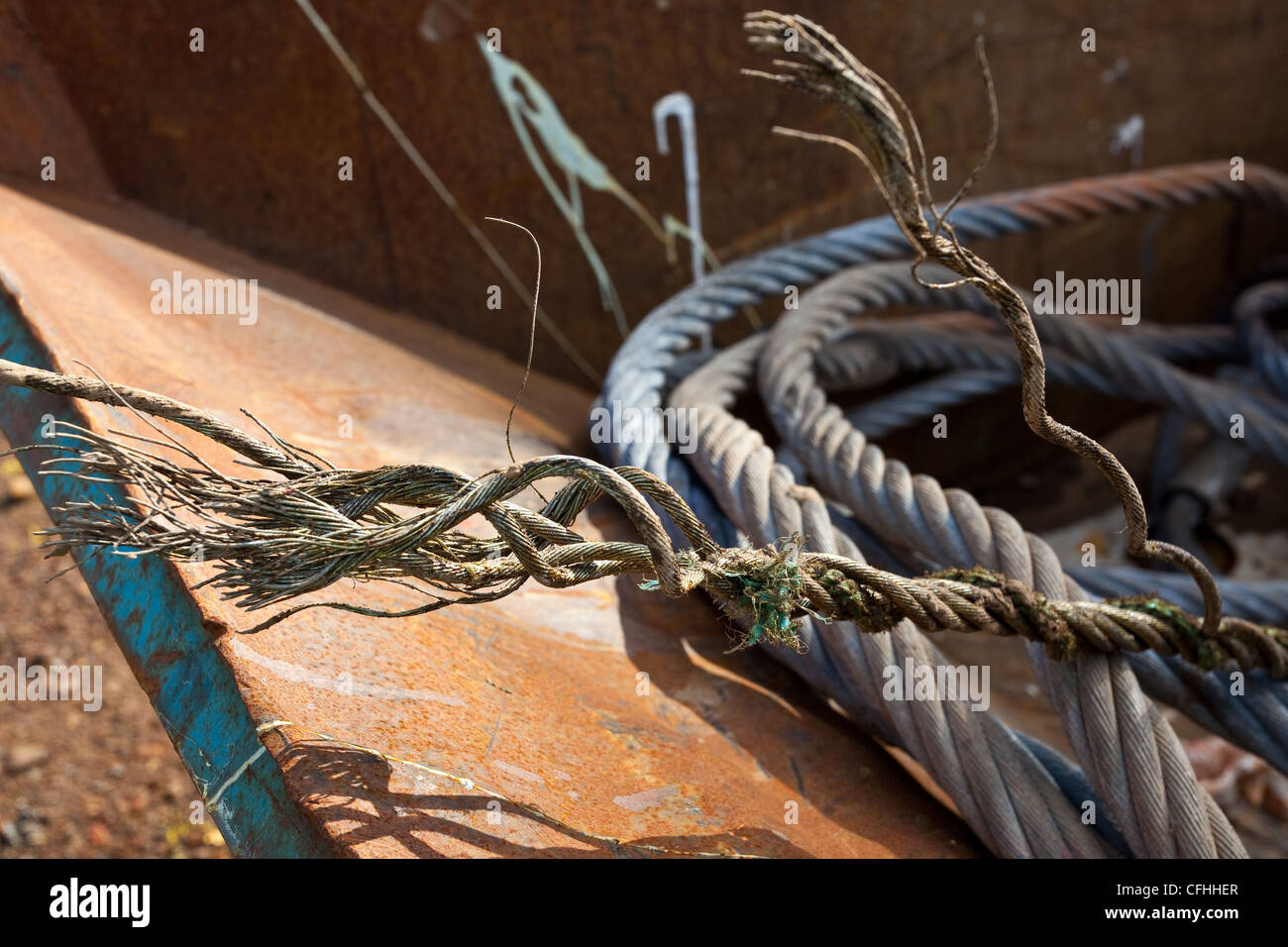 Broken Electric Wire Cable : Close up of a corroded or broken wire rope left in waste