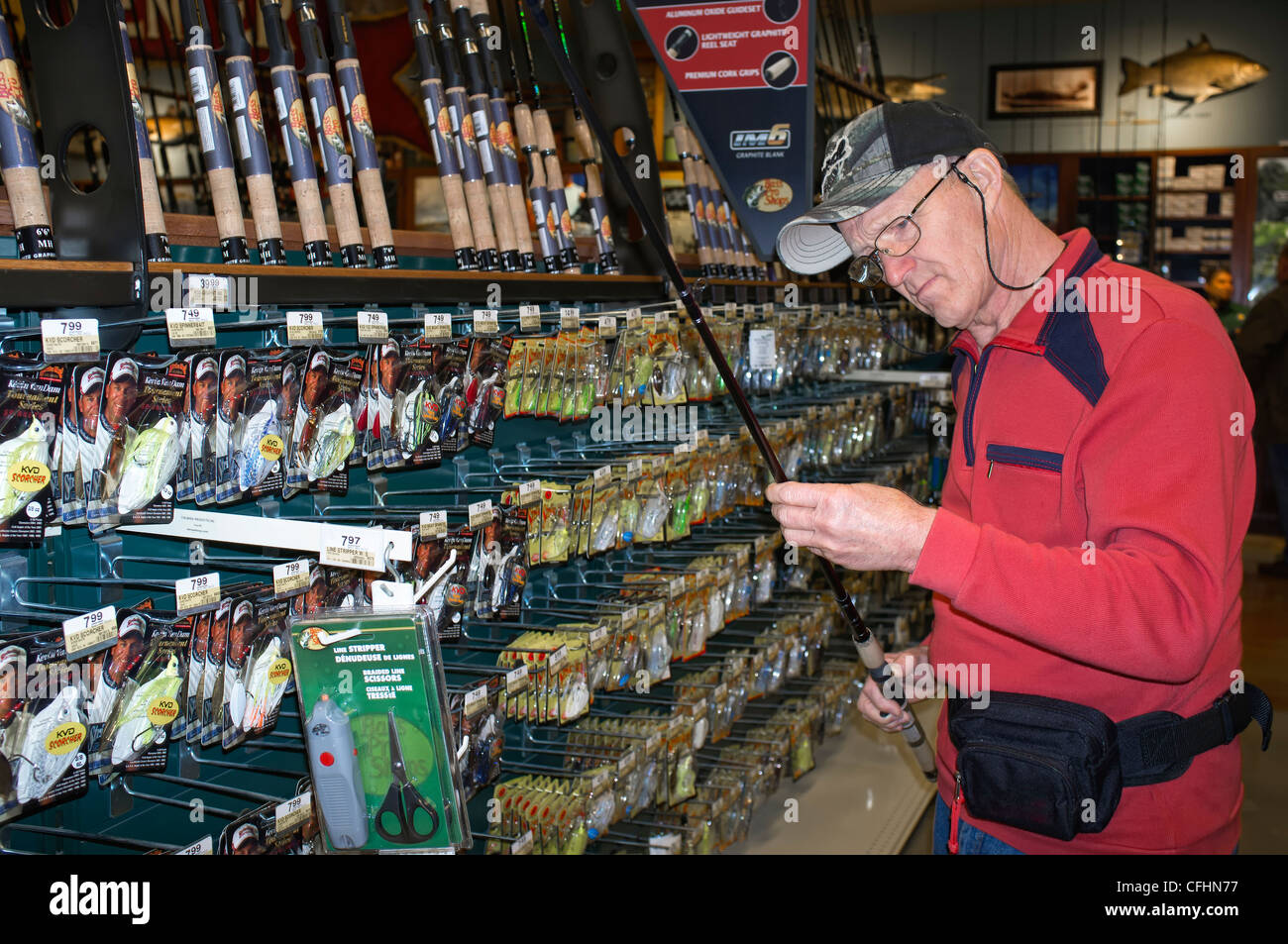 Old man angler checking fishing rod in outdoor equipment for Bass fishing in san antonio