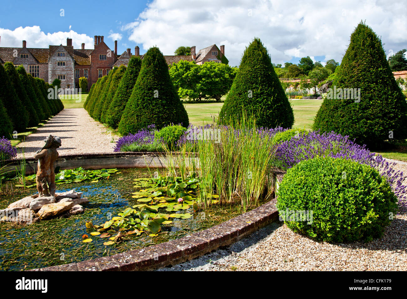 Ornamental pond statue and topiary in the english country for Ornamental pond