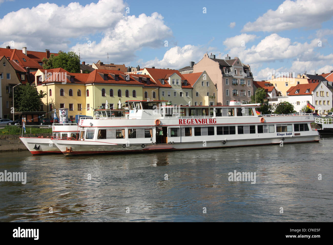 the regensburg river cruise boat moored on the danube river at stock photo royalty free image. Black Bedroom Furniture Sets. Home Design Ideas