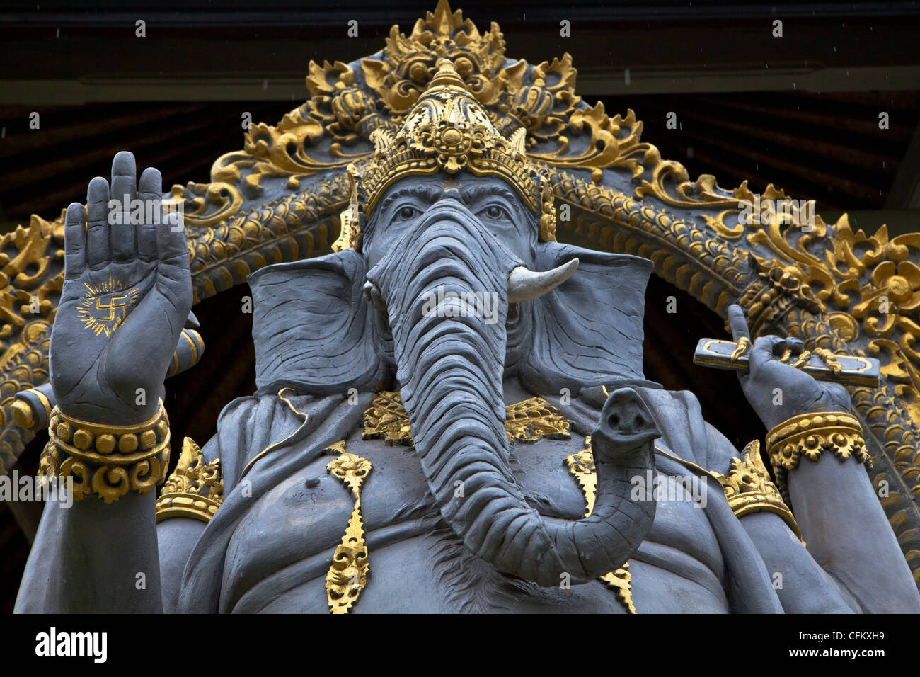 Balinese carved stone statue of ganesh in hindu temple