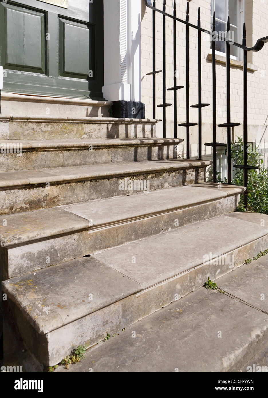 Old stone steps leading to front door UK