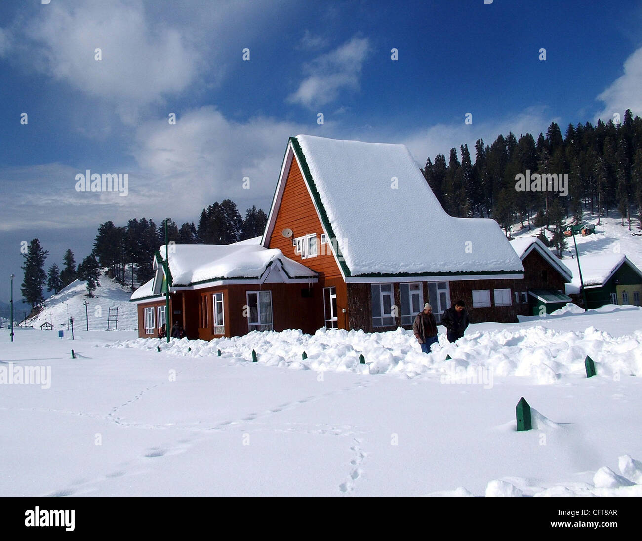 A beautiful view of snow covered trees and houses in gulmarg kashmir famous in whole world