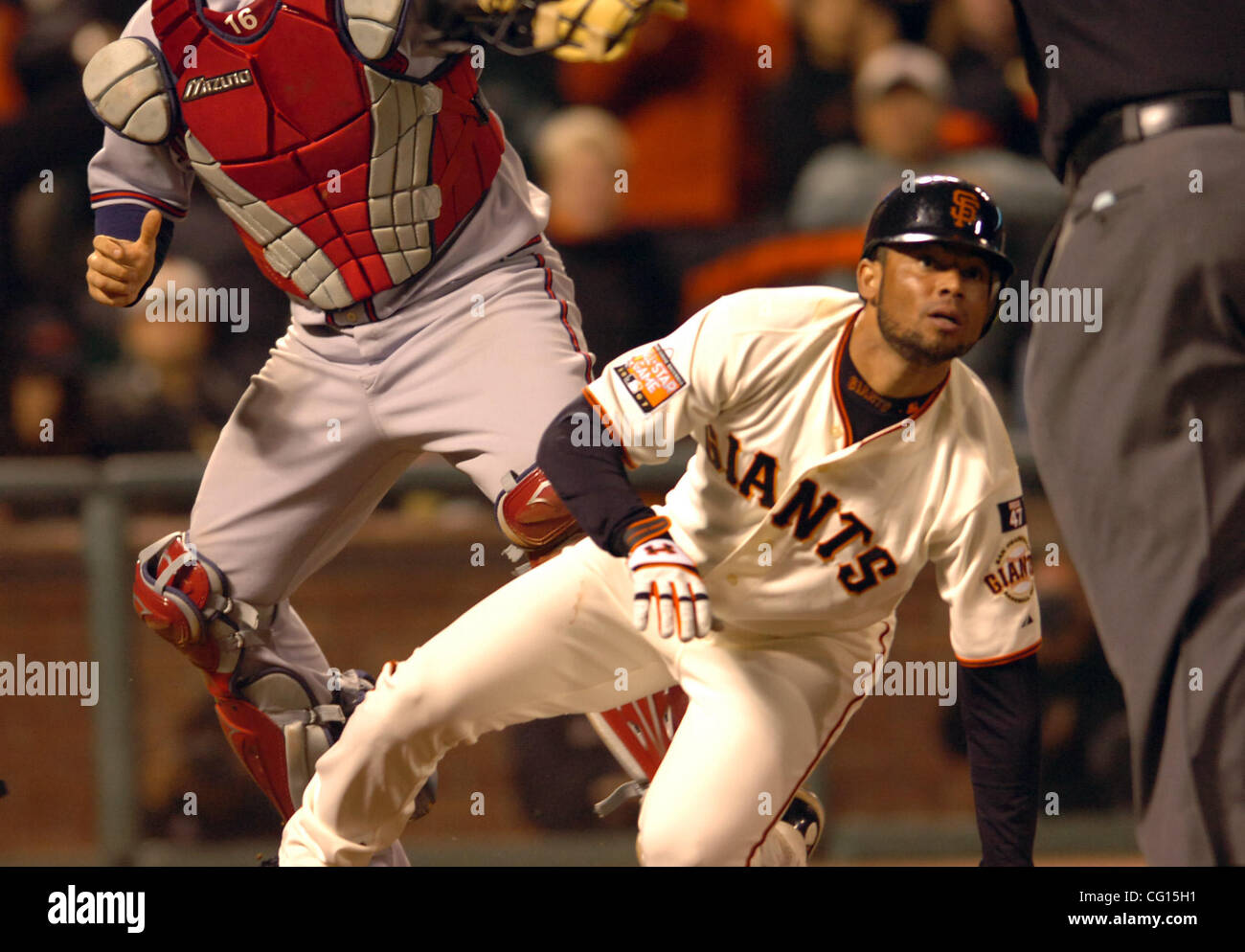 Pedro Feliz Of The San Francisco Giants Awaits A Safe Call From Home Plate Umpire Bruce