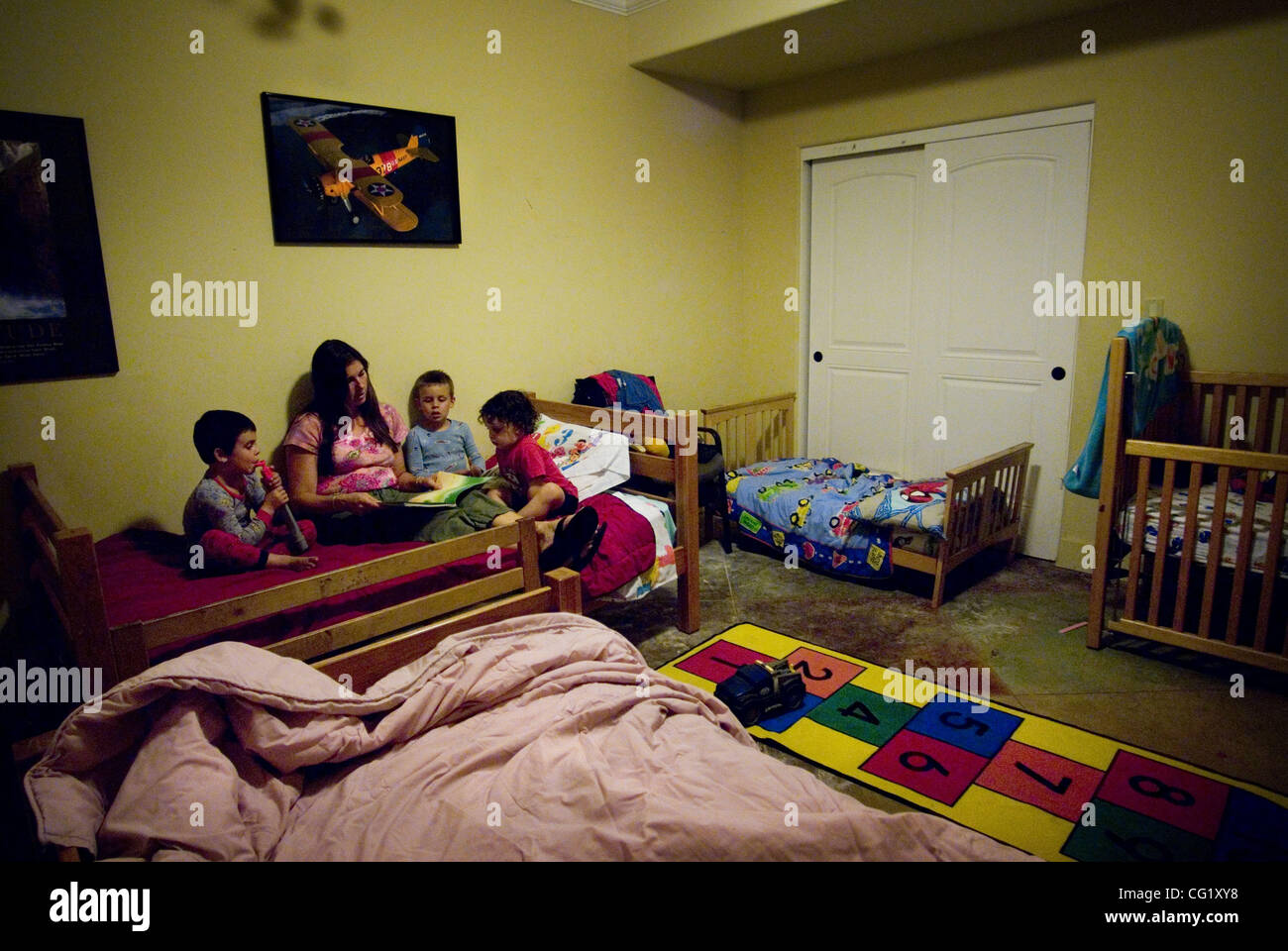 to her youngest children from left nicholas 3 christian 5 and joey 2 in their el dorado home august 21 the three boys share one bedroom