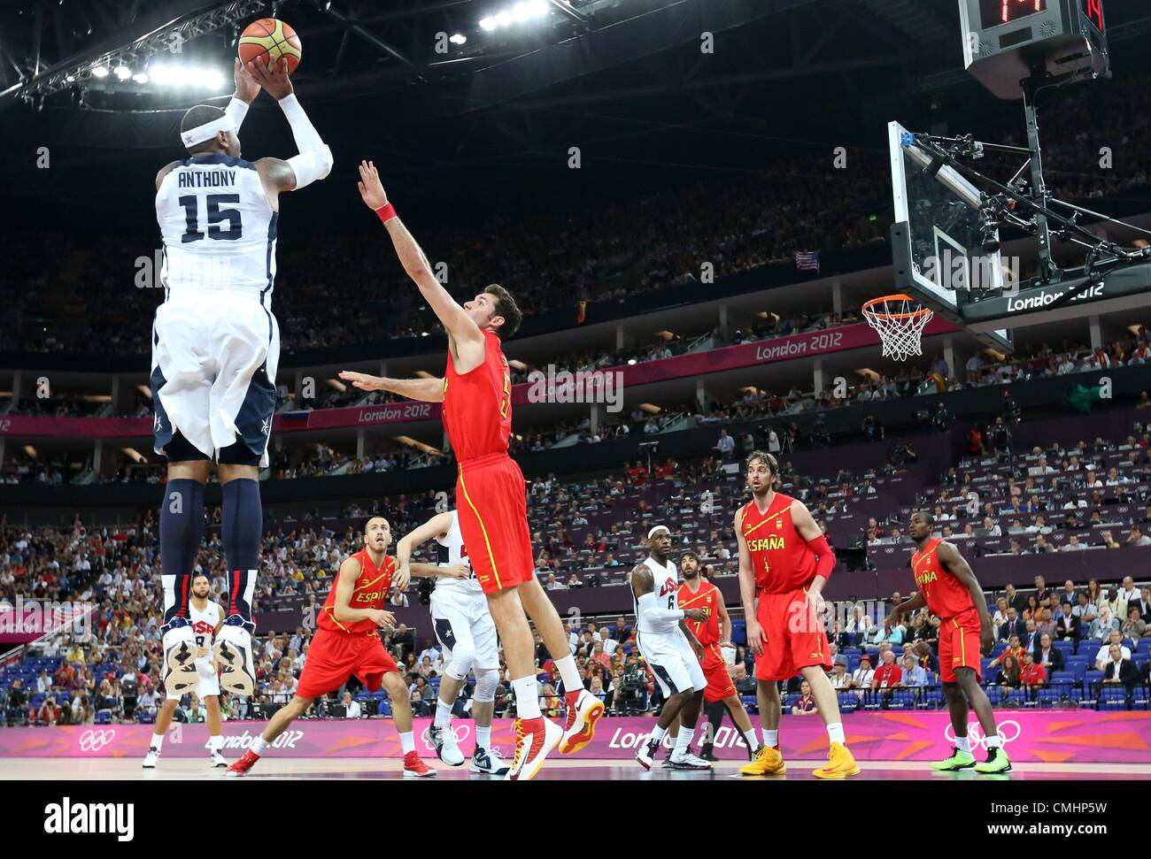 London uk sunday 12th august 2012 carmelo anthony of usa l carmelo anthony of usa l with a jump shot against rudy fernandez c of spain during basketball final game in north greenwich arena at the london voltagebd Choice Image