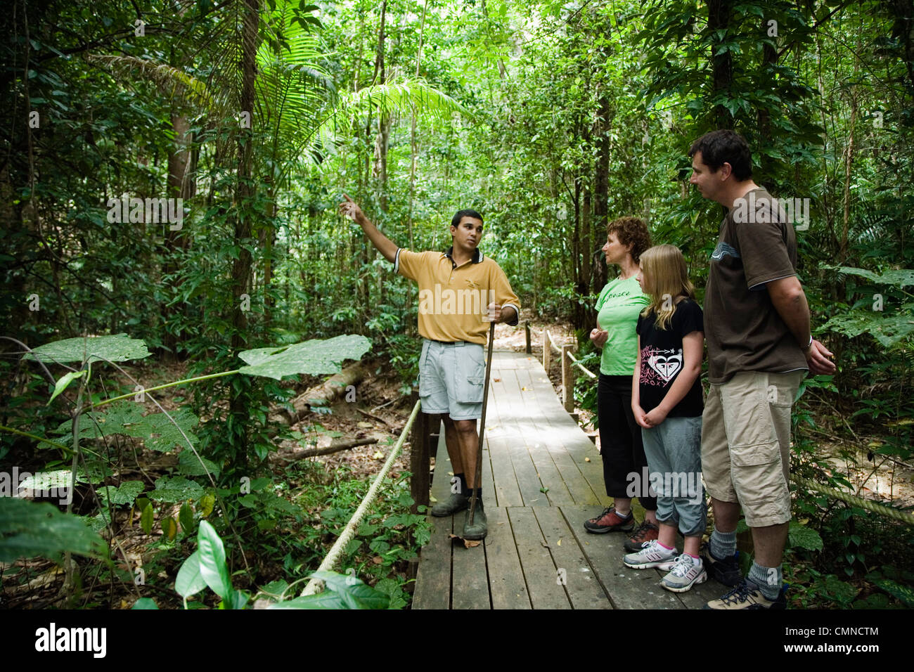 Indigenous Guide And Family On Tour Of Rainforest At Daintree Eco Stock Photo Royalty Free