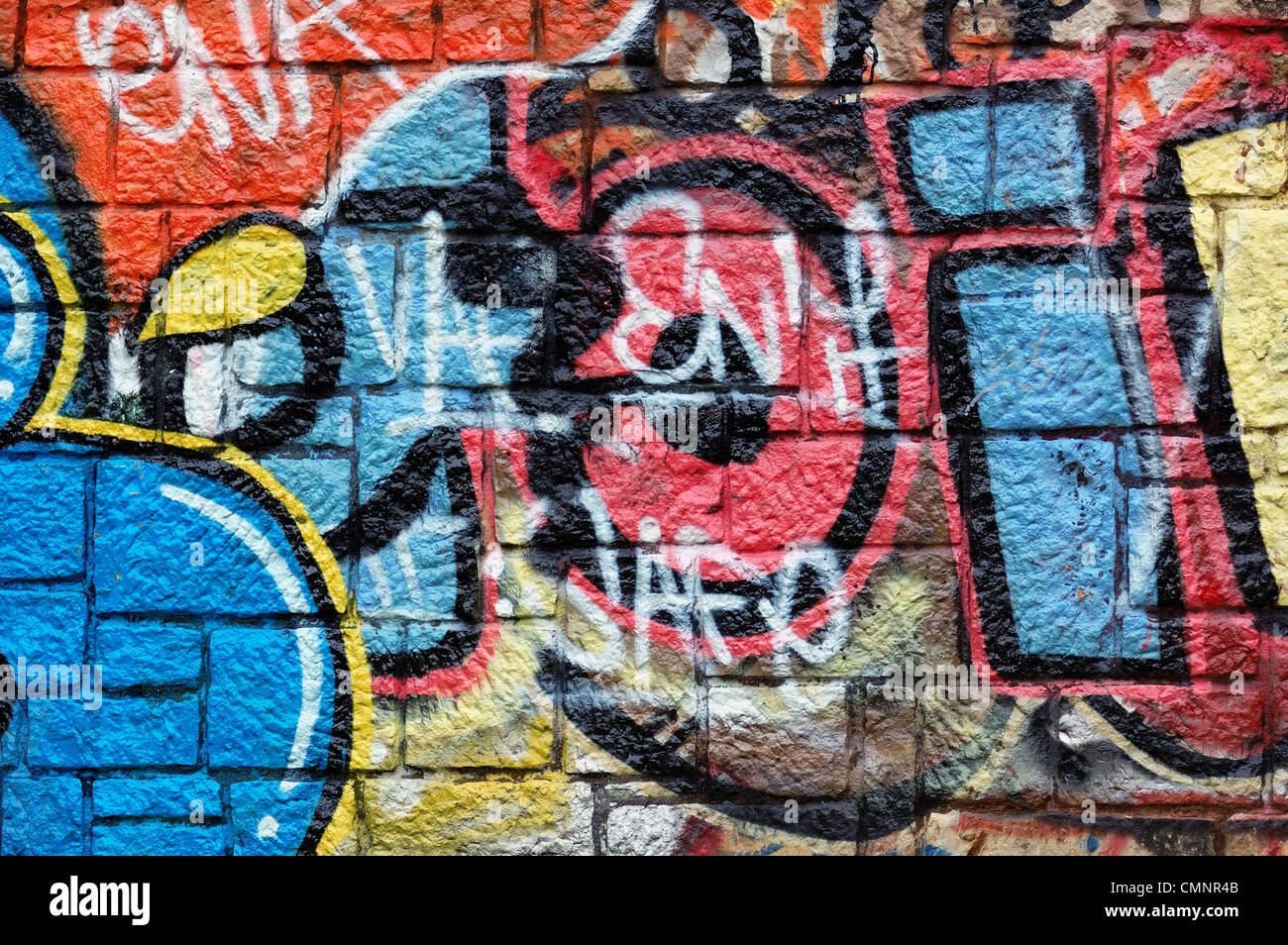 Graffiti art background - Stock Photo Wall With Overlapping Layers Of Messy Graffiti And Tags Urban Street Art Background