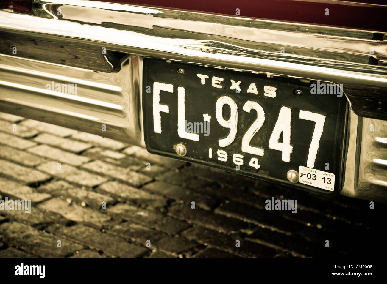 1964 Texas license plate mounted on the chromed back of an old car ...