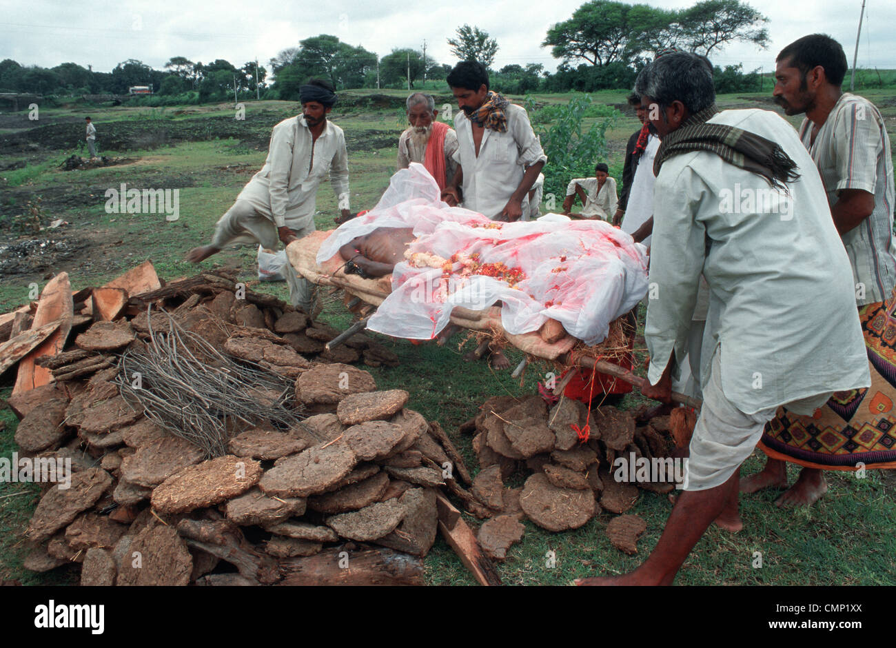 Hindu funeral ritual : a corpse is carried to the pyre by the male ...