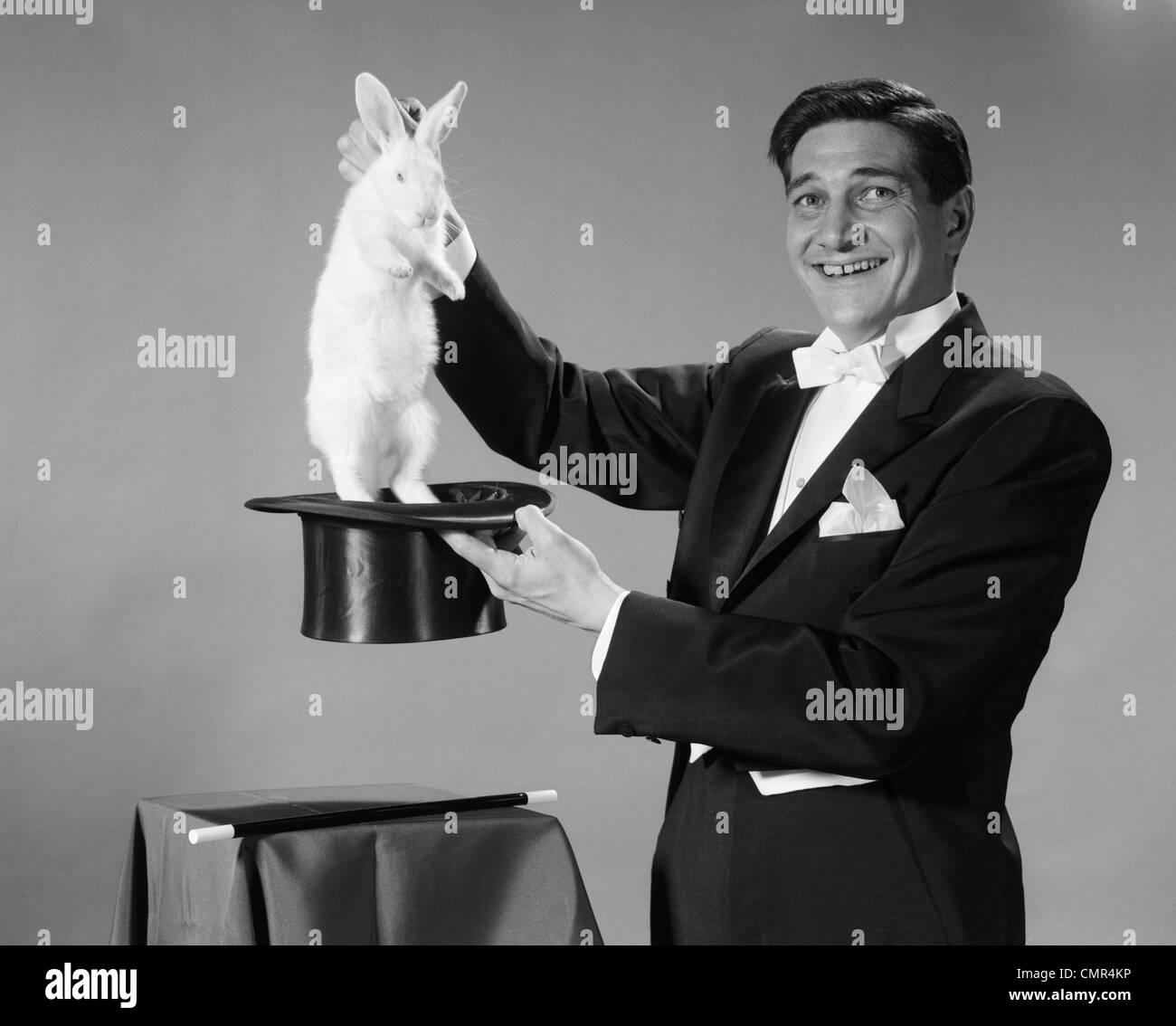 1960s MAN PORTRAIT SMILING MAGICIAN PULLING WHITE RABBIT ...