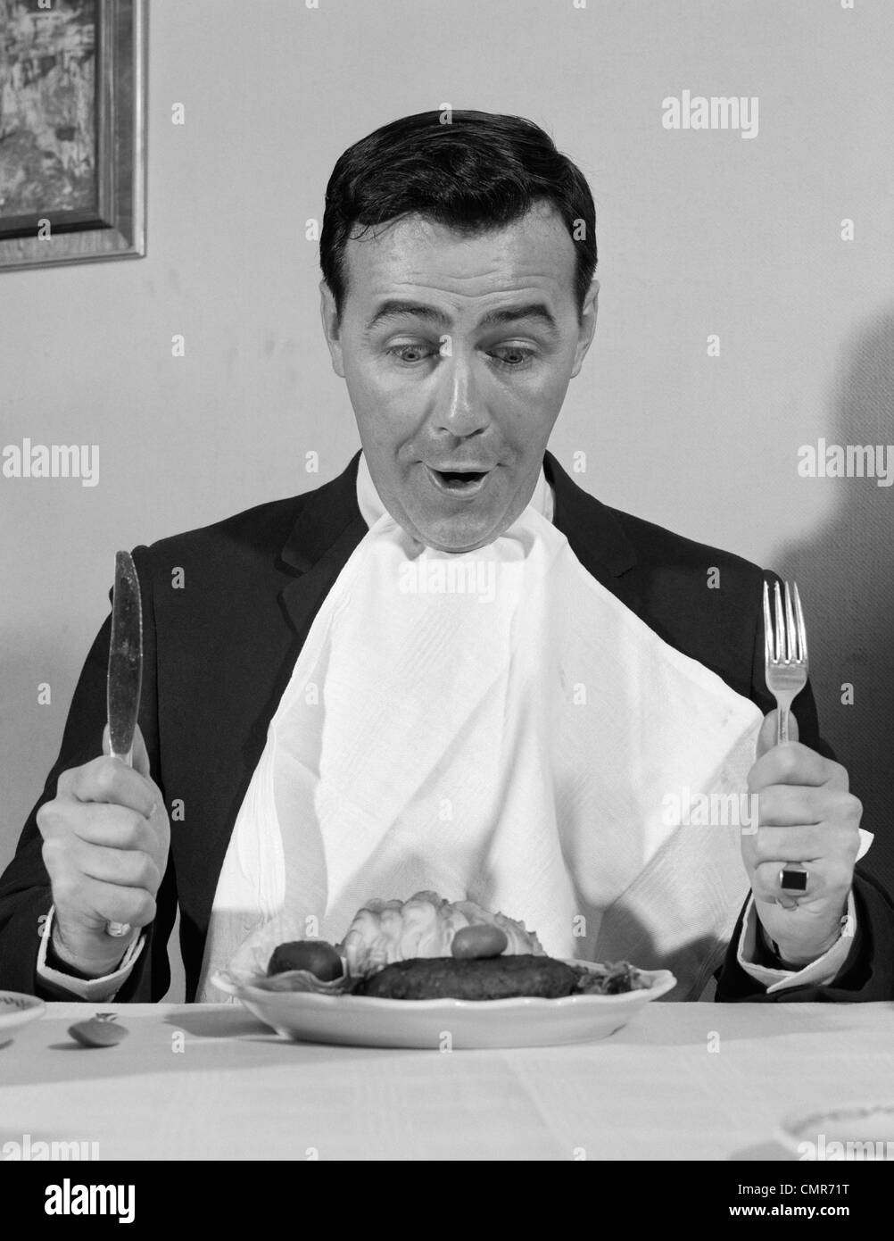 1960s Man Sitting At Table Ready To Eat Dinner With Napkin  : 1960s man sitting at table ready to eat dinner with napkin at neck CMR71T from www.alamy.com size 1002 x 1390 jpeg 118kB