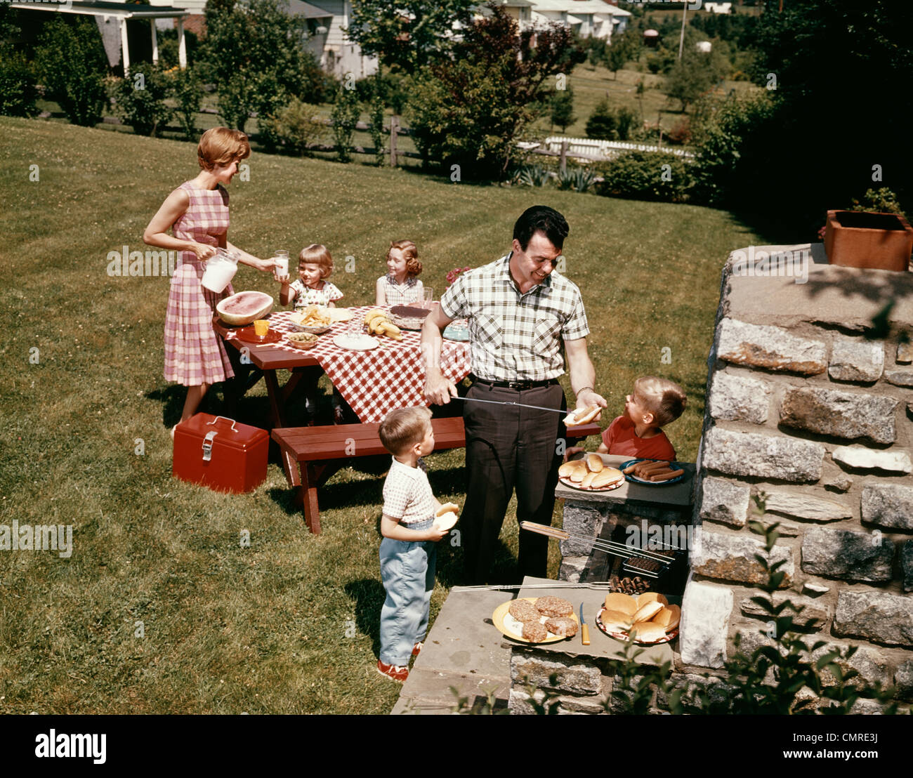1960s FAMILY FATHER MOTHER TWO DAUGHTERS TWO SONS BACKYARD