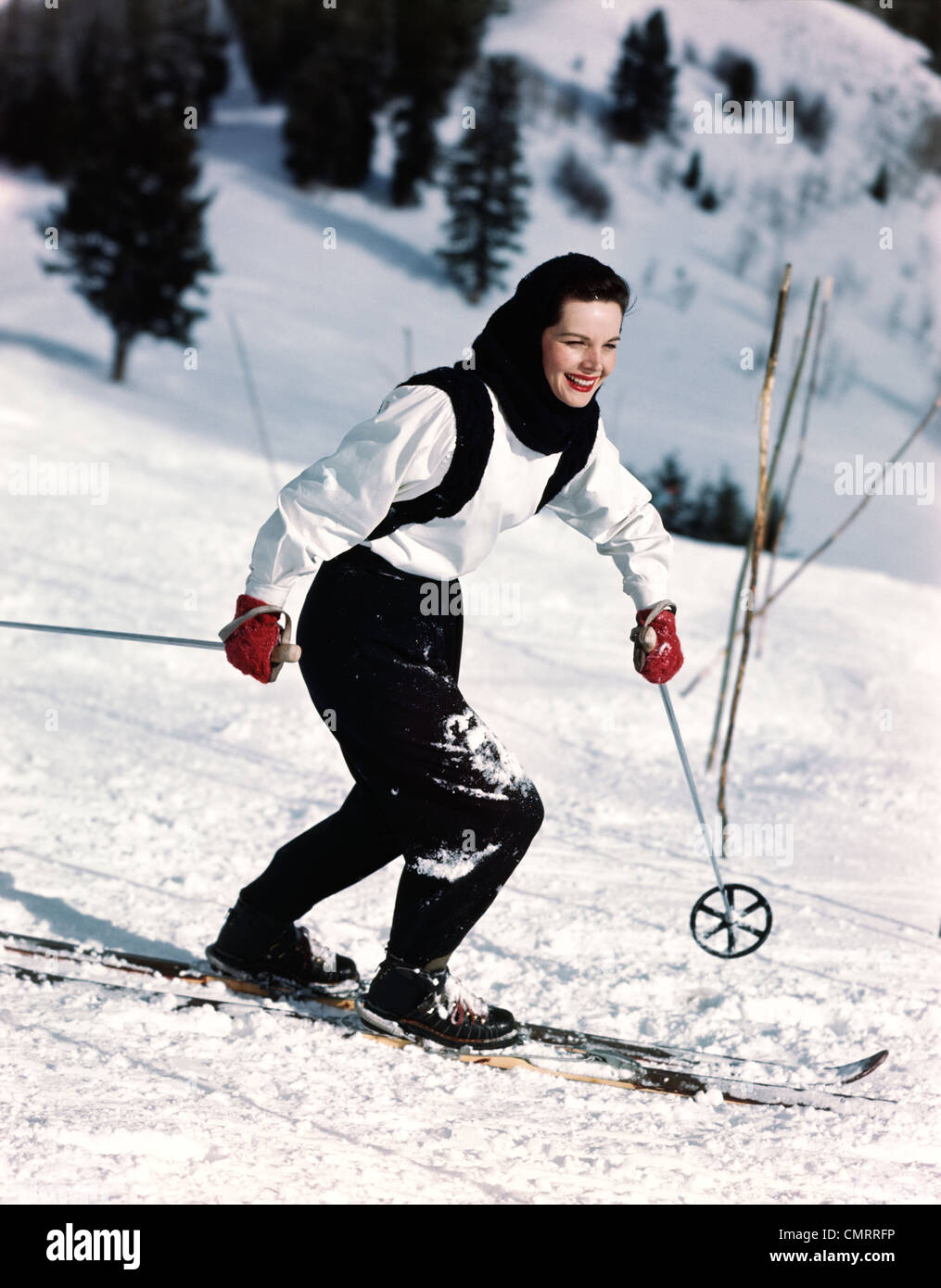 1940s 1950s SMILING WOMAN SKIING WEARING BLUE AND WHITE SKI OUTFIT WITH RED  GLOVES