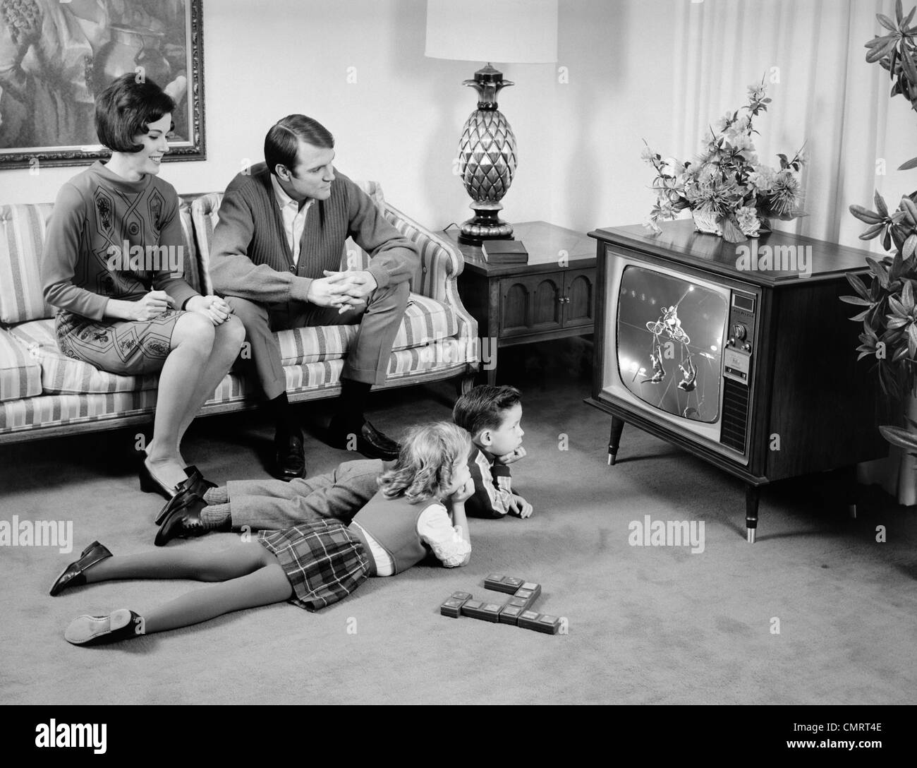 black kids watching tv. 1960s family of 4 watching television in living room parents on couch kids lying floor black kids watching tv