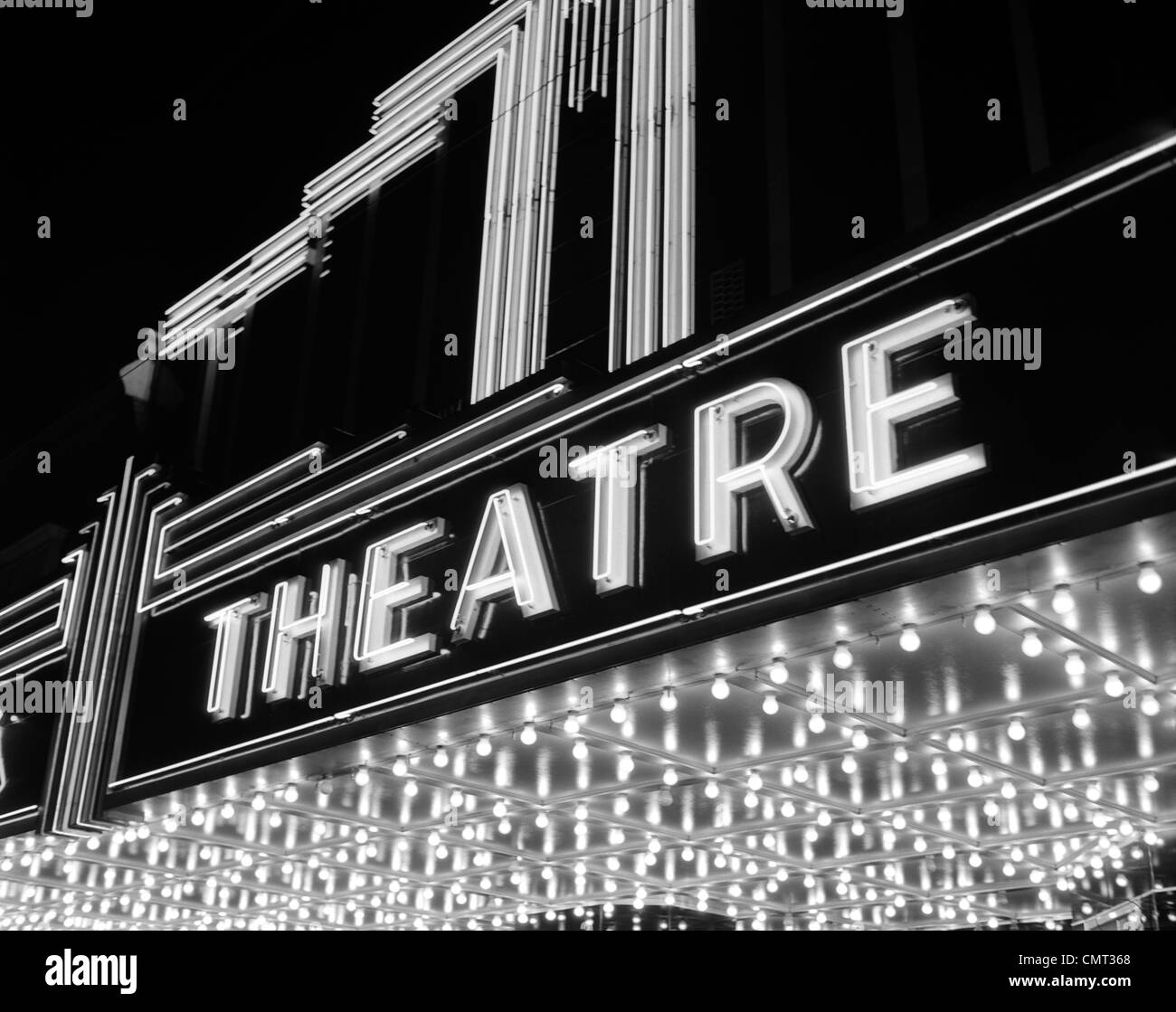 1930s 1940s THEATER MARQUEE THEATRE IN NEON LIGHTS Stock Royalty Free