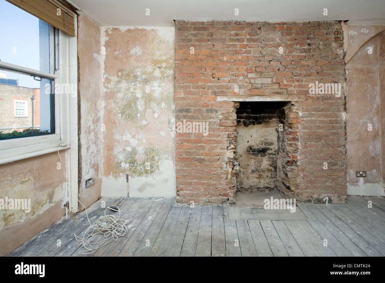 Renovate Brick Fireplace Room Undergoing Renovation With Brick Fireplace Stock Photo
