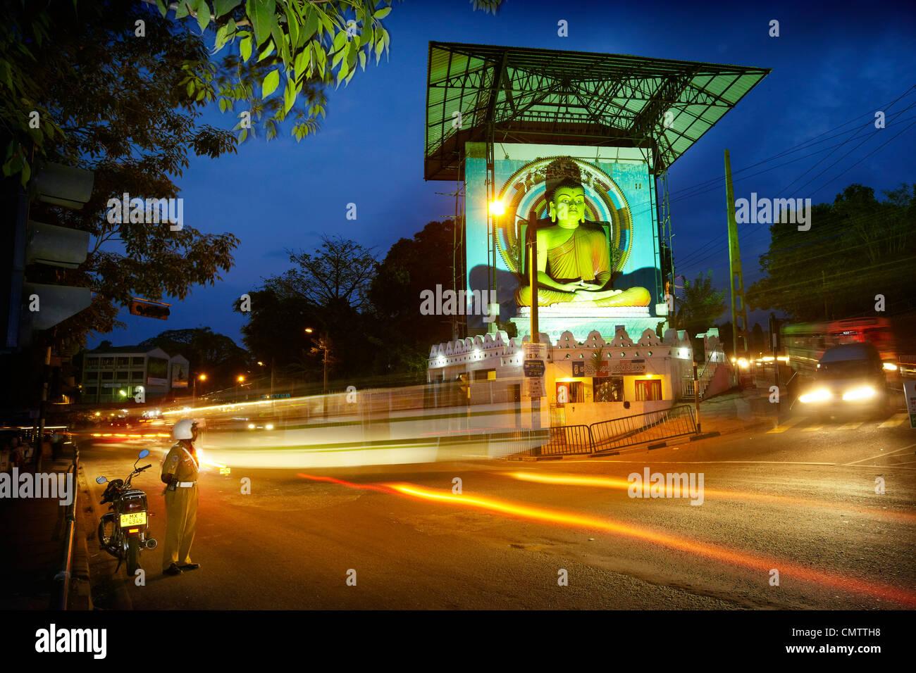 Sri Lanka, Kandy - Buddha statue in the city center, city by night ...