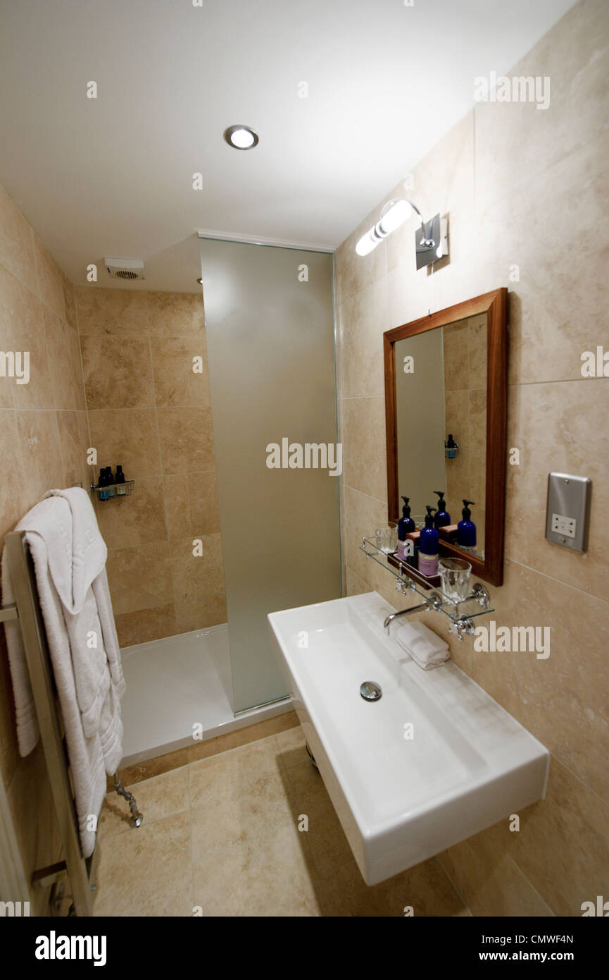 Modern compact hotel show home bathroom wet room with for Show home bathrooms