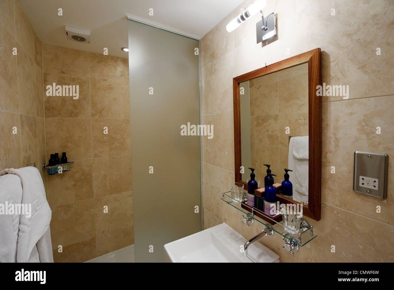modern compact hotel show home bathroom wet room with oblong sink ...