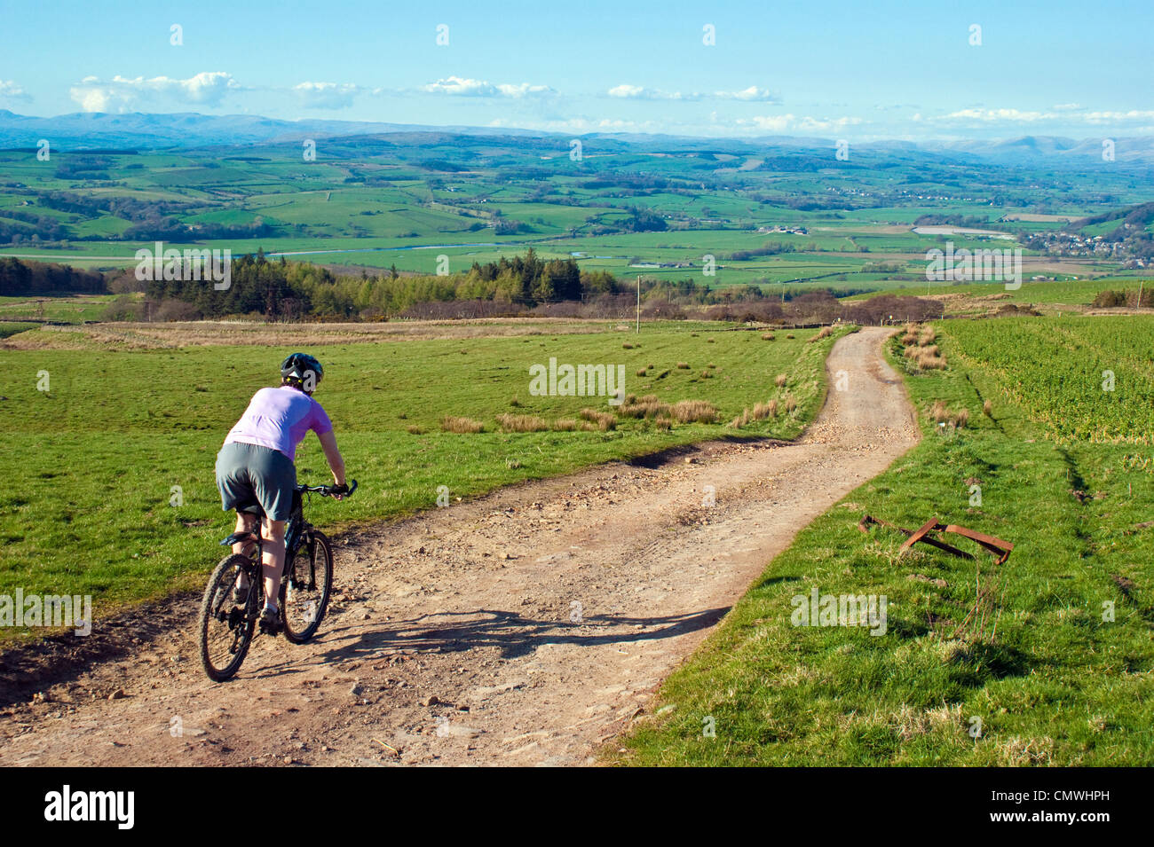 female-mountain-biker-descending-on-cato