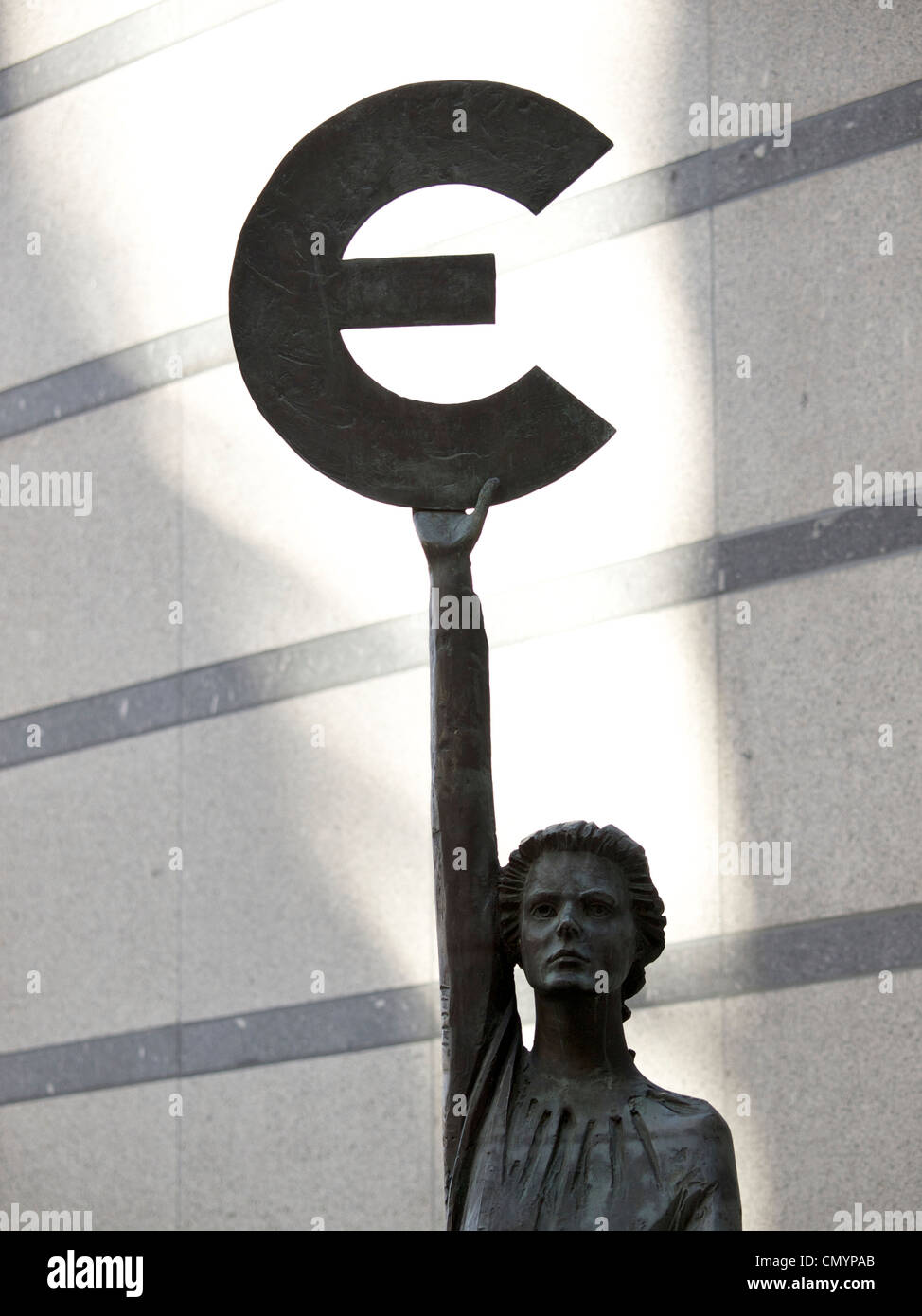 Bronze statue woman goddess europa holding up euro currency symbol bronze statue woman goddess europa holding up euro currency symbol in front of the european parliament brussels belgium biocorpaavc Images