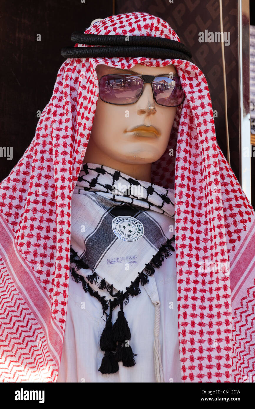 Arab traditional clothes stock photos arab traditional clothes clothes shop dummy dubai wearing traditional headdress gutra and agal of the publicscrutiny Image collections