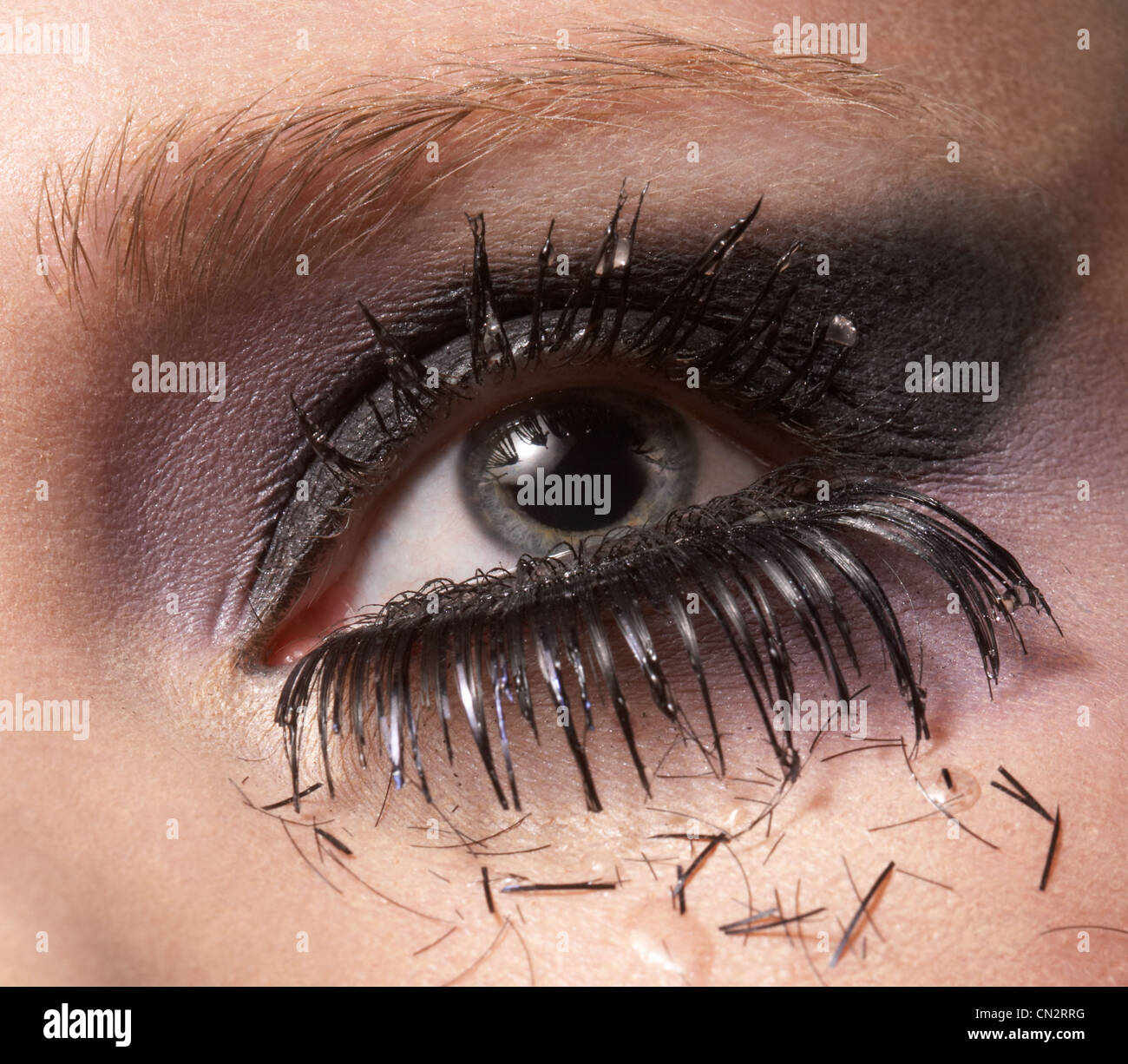 Female eye with pieces of eyelash and tears Stock Photo, Royalty ...