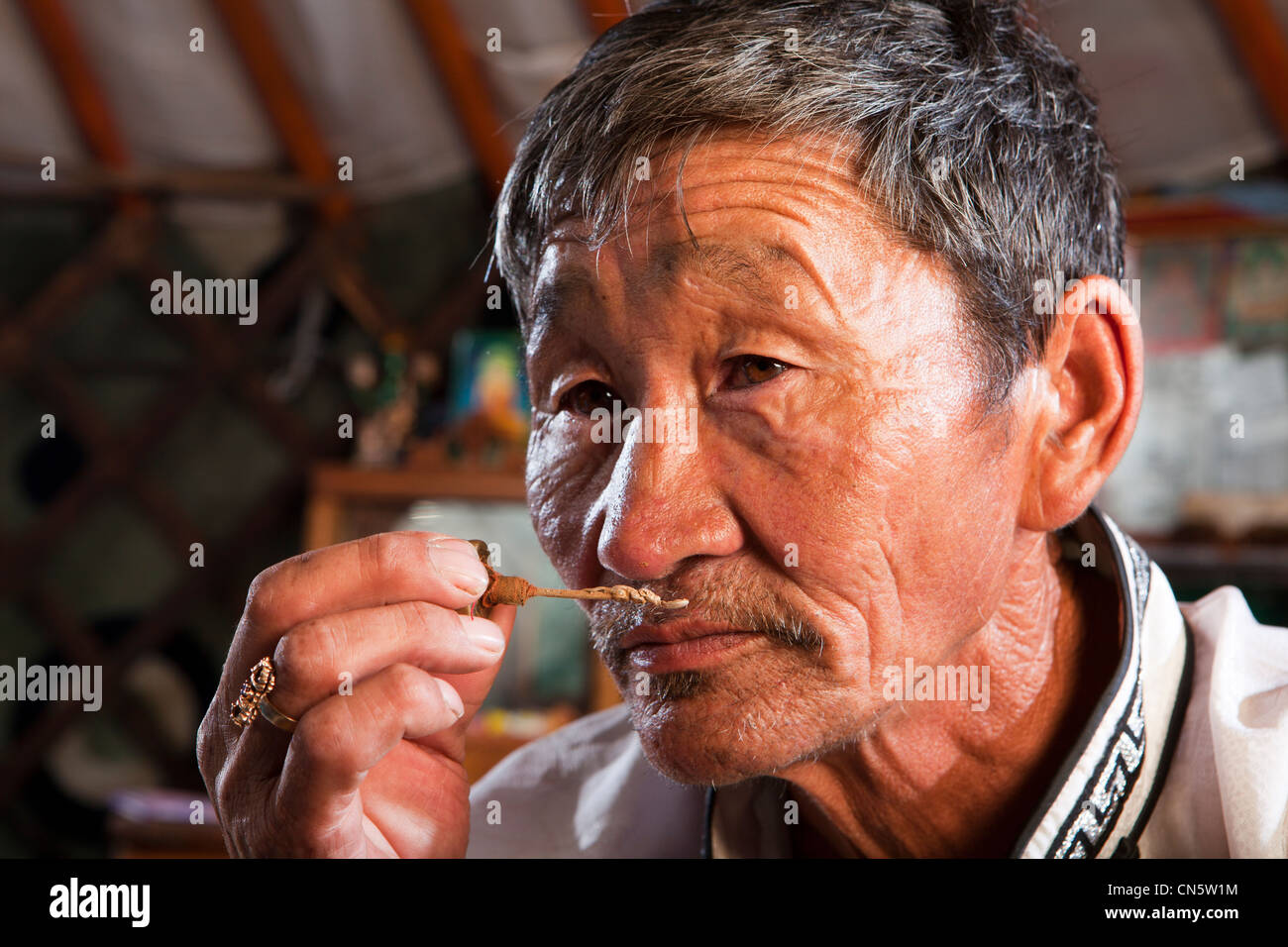 mongolian-man-smelling-traditional-aroma