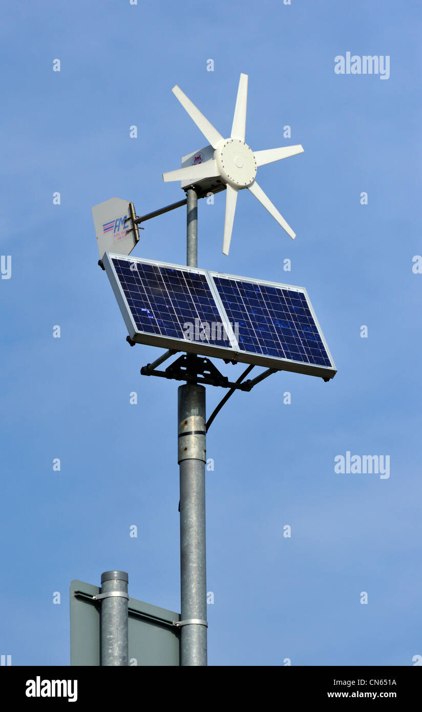 Solar Panel And Wind Turbine Powering A Road Sign