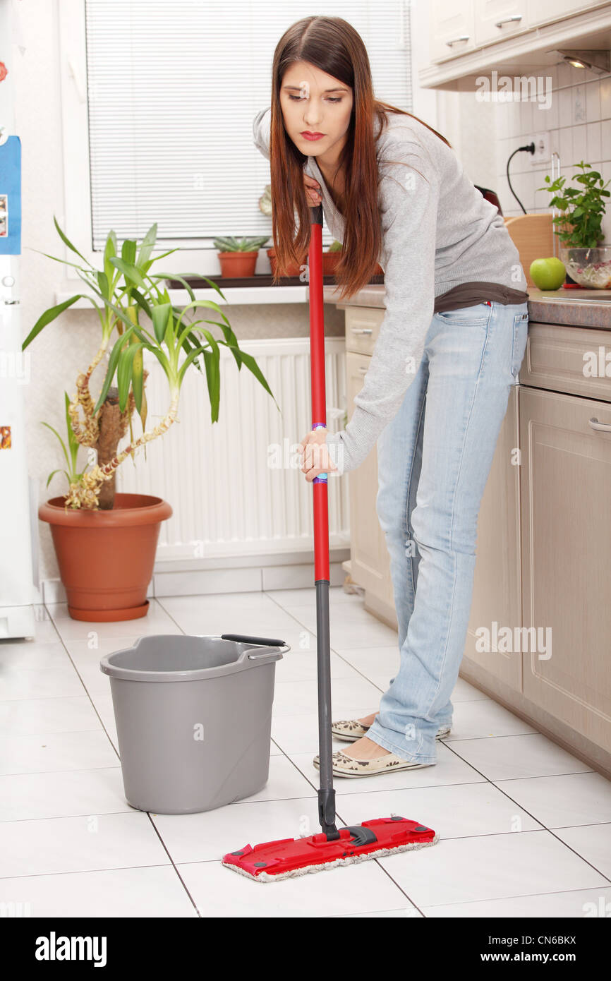 Kitchen Floor Mops Woman Holding A Mop And Cleaning Kitchen Floor Stock Photo