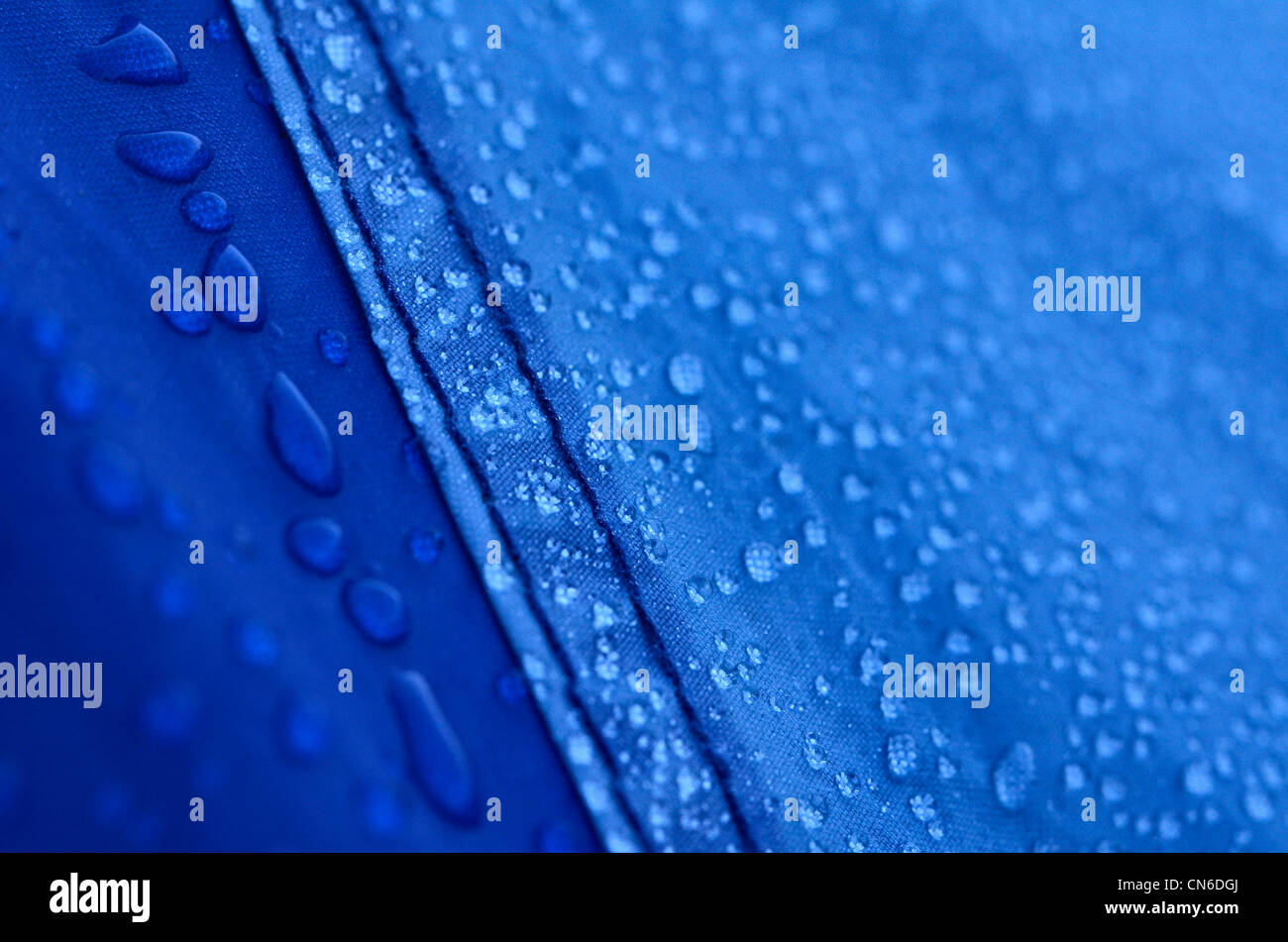 Close detail of morning dew beading on tent fly-sheet surface (shallow focus & Close detail of morning dew beading on tent fly-sheet surface ...