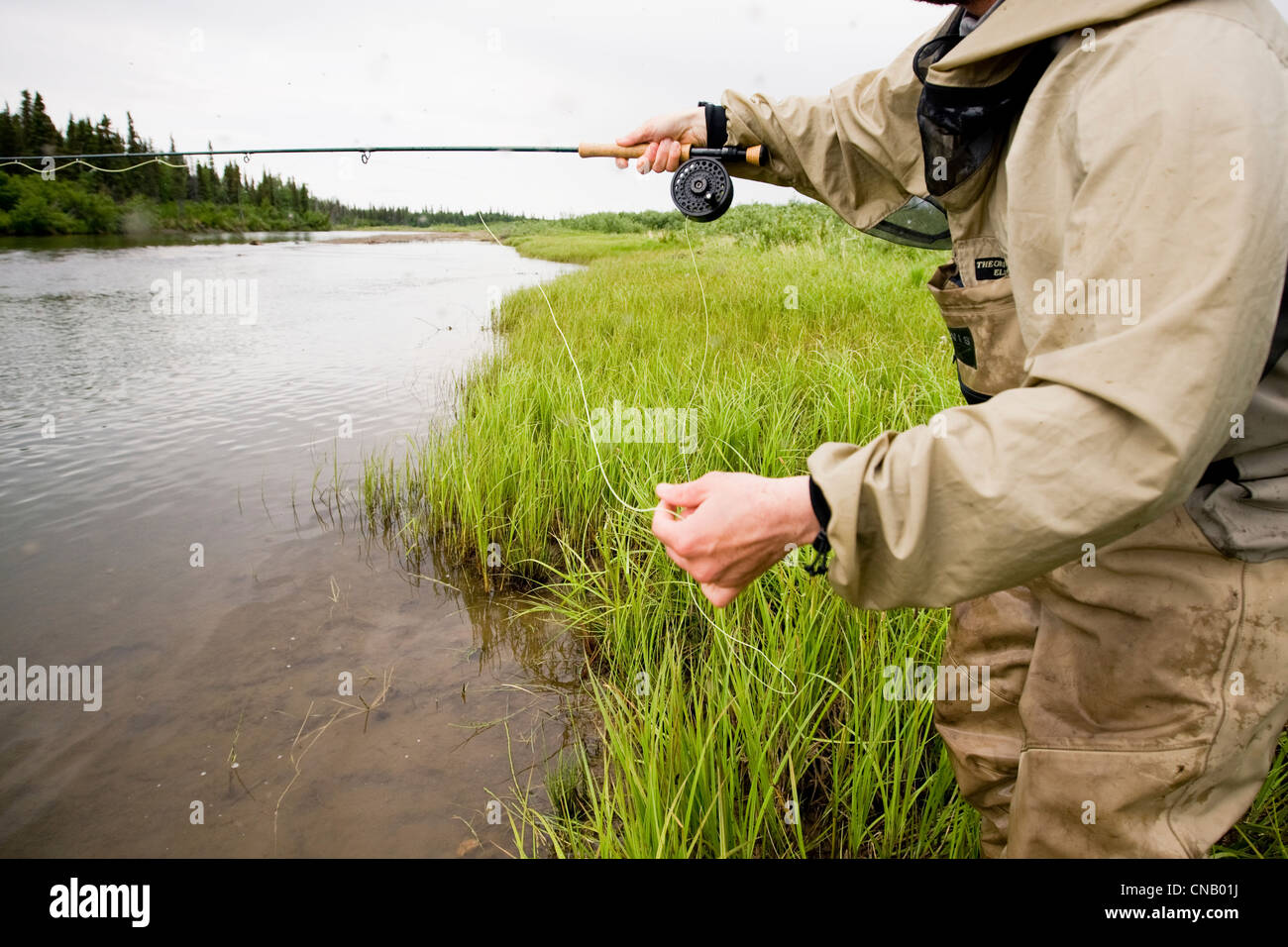 Fly fisherman fishing for salmon on the mulchatna river in for Fly fishing bay area