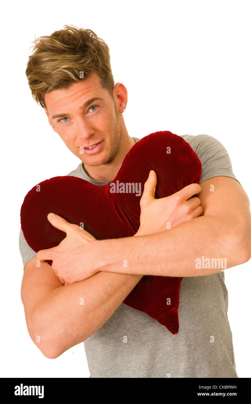 Man Shaped Pillow Young Man Embracing A Heart Shaped Pillow Stock Photo Royalty
