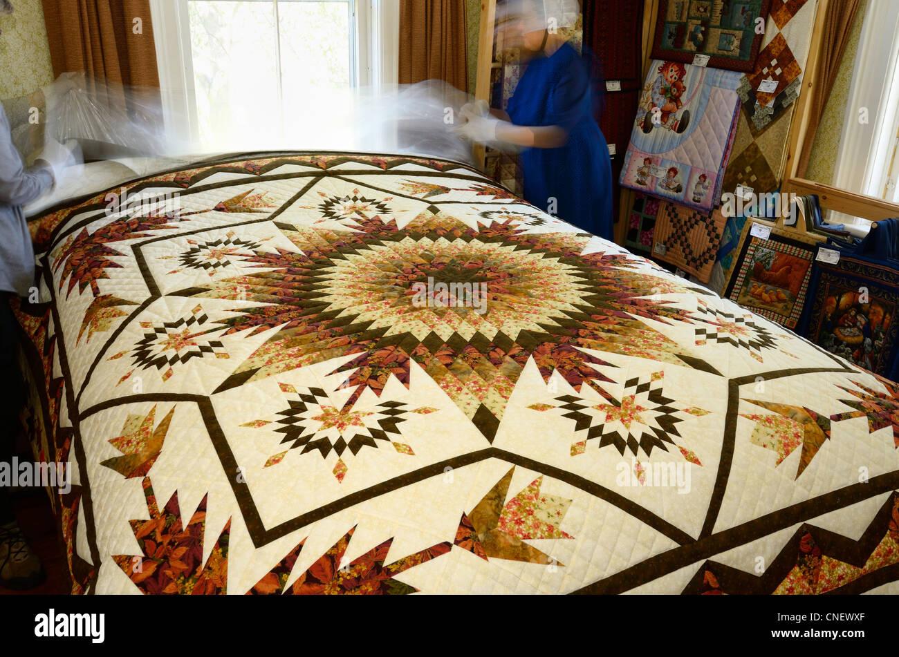 Mennonite Bedroom Furniture Mennonite Seamstress Showing Handmade Quilts In Her Bedroom Near