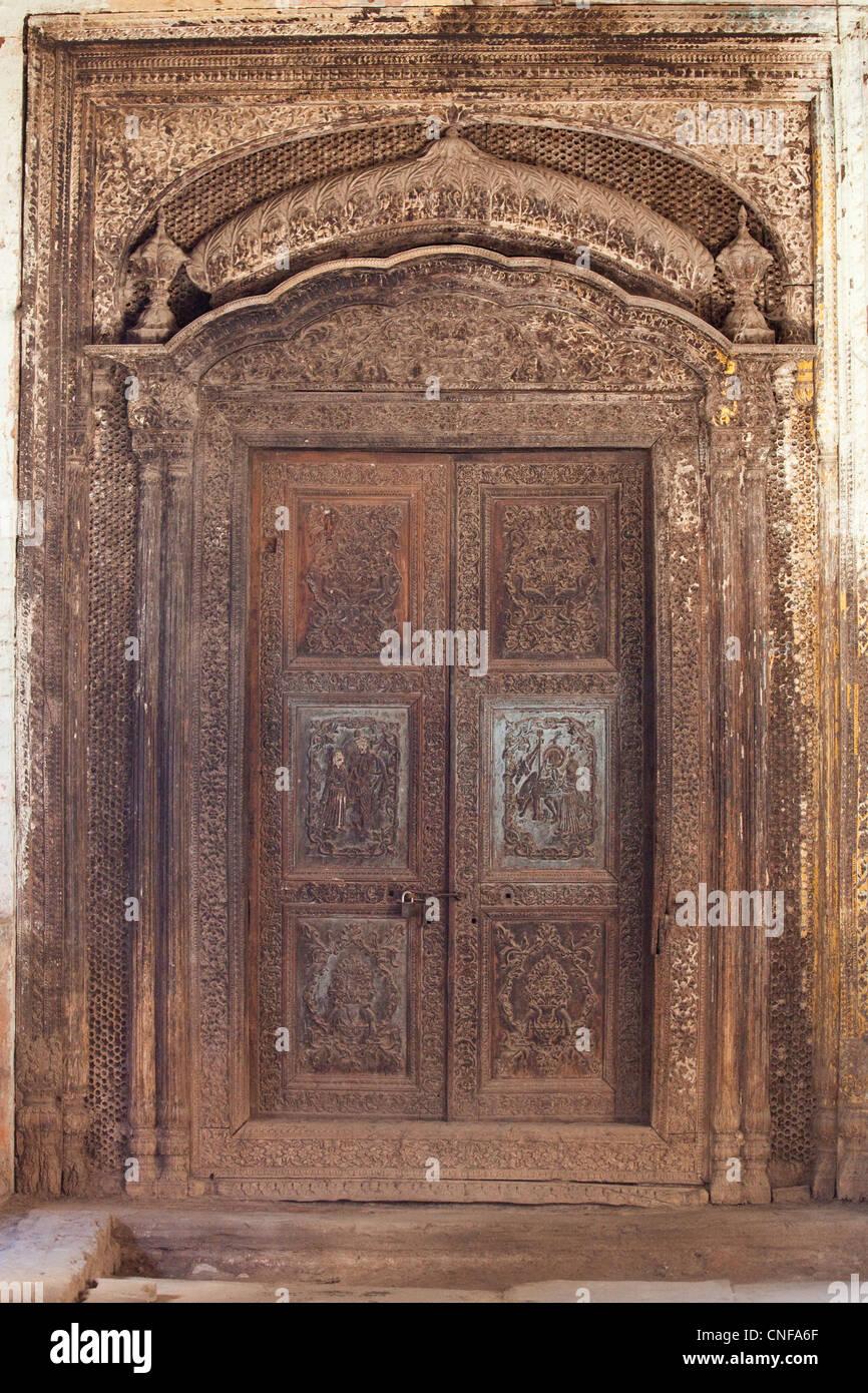 Ornate wooden door in old town rawalpindi pakistan stock for Wood doors in pakistan