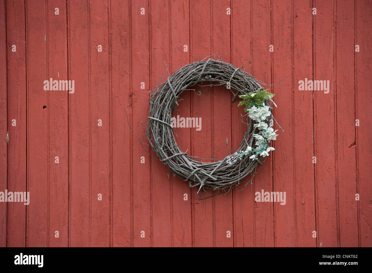 red barn door. Grapevine Wreath Decoration Hanging On A Red Barn Door L