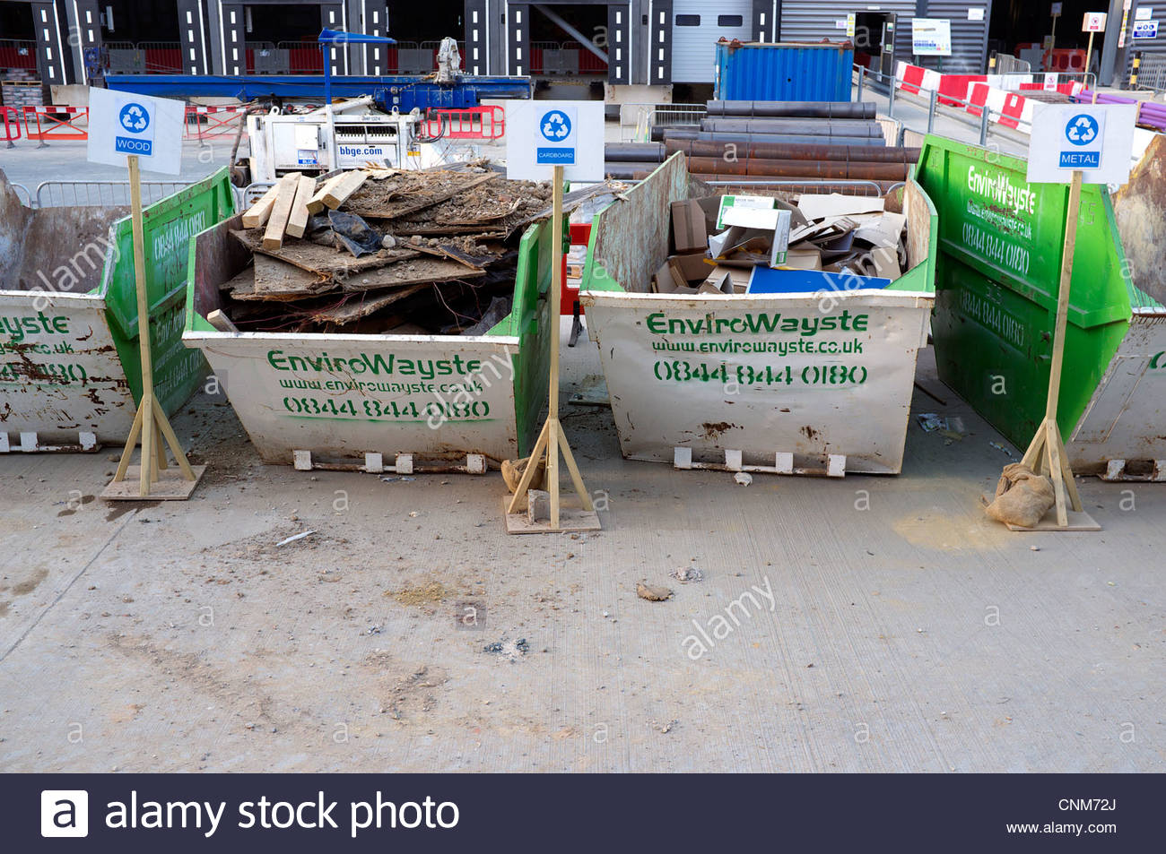 Construction site skips for different waste materials for for Recycling of waste material