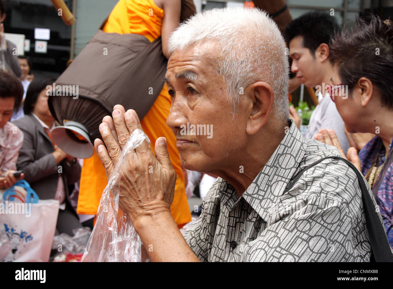 Traditional thai wai stock photos traditional thai wai stock portrait of an old thai man in thai traditional greeting wai stock image kristyandbryce Images