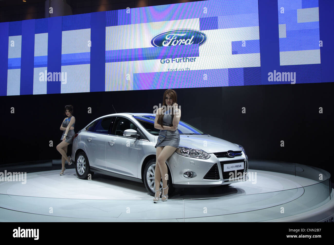 Model Presenters Posing With Ford Car In Thailand Motor Show 2012