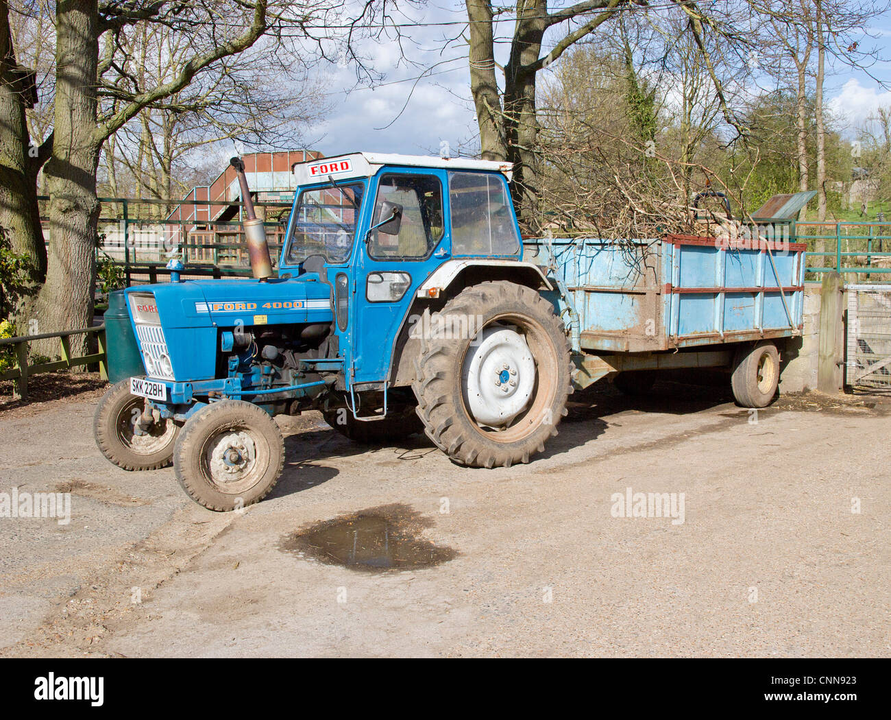 Ford 4000 tractor with loaded trailer attached stock image