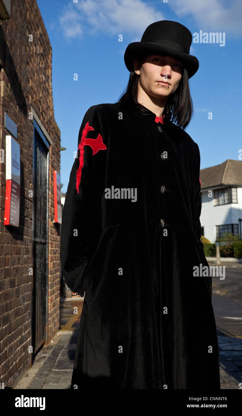 Half length portrait of a Goth young man, wearing a long black ...
