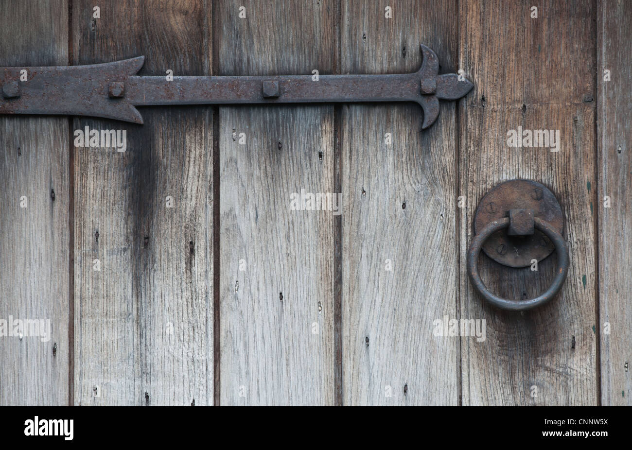 925 #675952 Old Wrought Iron Hinges And Door Handle On Weathered Wooden Door Stock  image Wrought Iron And Wood Doors 40031300